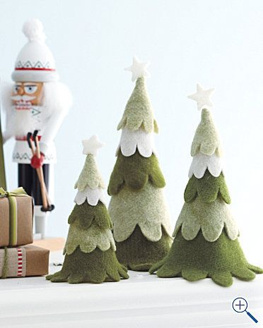 Felt trees! They look like the ones from Rudolph... I'm going to need more shelves for all of these decorations...