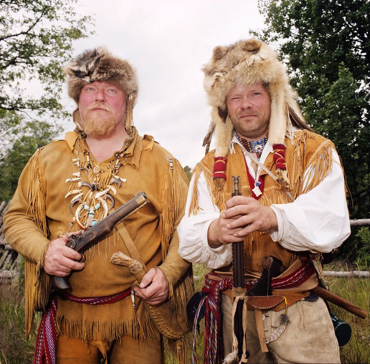 Quirky Culture Swap- Picture of two men dressed as fur trappers at a park in Sweden