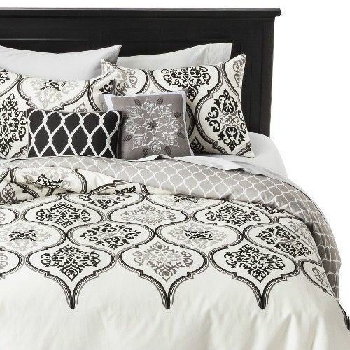love the print on this white and black bedding set and the mix of pillow prints