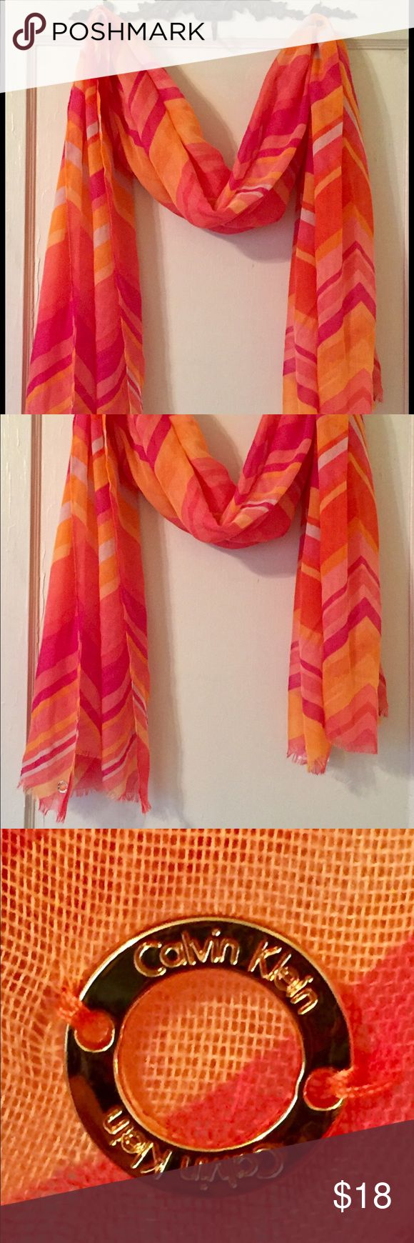Calvin Klein Sunset Scarf NWT Calvin Klein Sunset Scarf! Shades of pink/orange and a large zig zag design. Totally 60's vibe.  Perfect to brighten up your OOTD or wear professionally.  100% Polyester Calvin Klein Accessories Scarves & Wraps