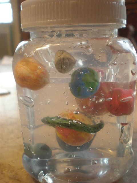 This is a small spice jar, clear hair gel, and clay from the dollar store made into a solar system display for your budding astronomer.