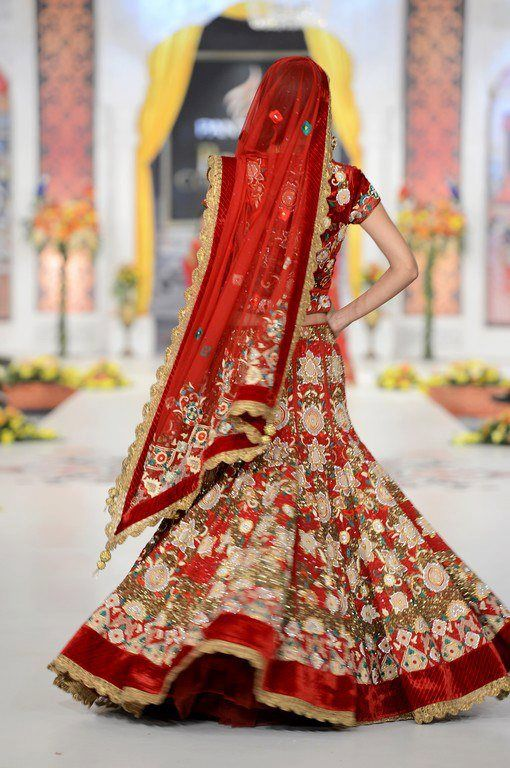 indian bridal lehenga gold and red Charu Parashar
