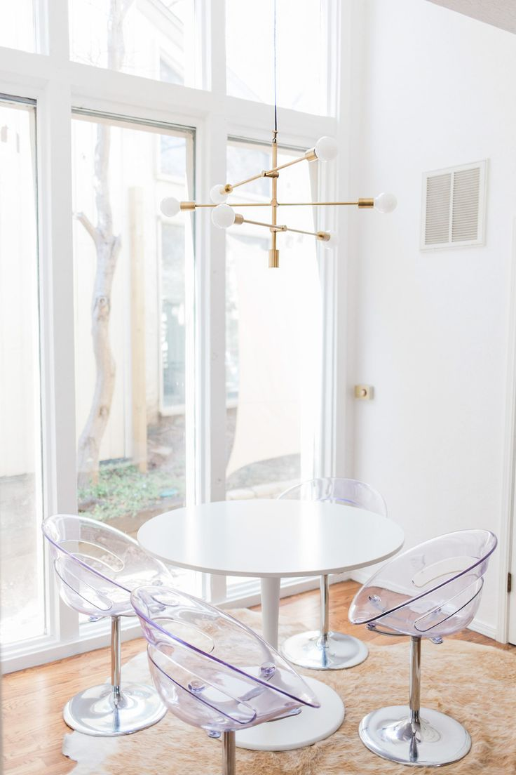Mid-century Tulsa home   photos by Melissa Click   shop the home: sofa - rug - tree stump - pillow - overarching floor lamp - planter - marble box - floor lamp - chandelier Follow Gravity Home: Blog -...
