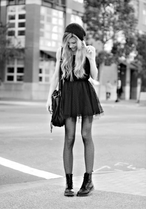 make a fancy feminine dress work for daytime by pairing it with combat boots. it makes the look way more casual