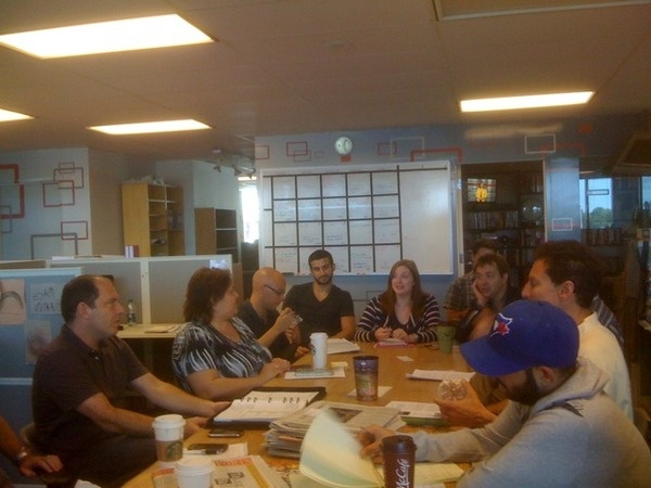 Our Thursday editorial meeting is underway. This is where producers pitch their ideas for upcoming programs.