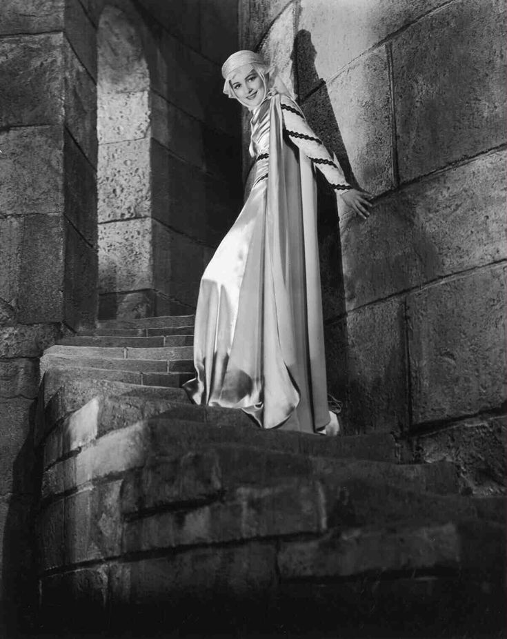 The Adventures of Robin Hood (1938)  Full shot of Olivia de Havilland as Maid Marian (Lady Marian Fitzswalter).