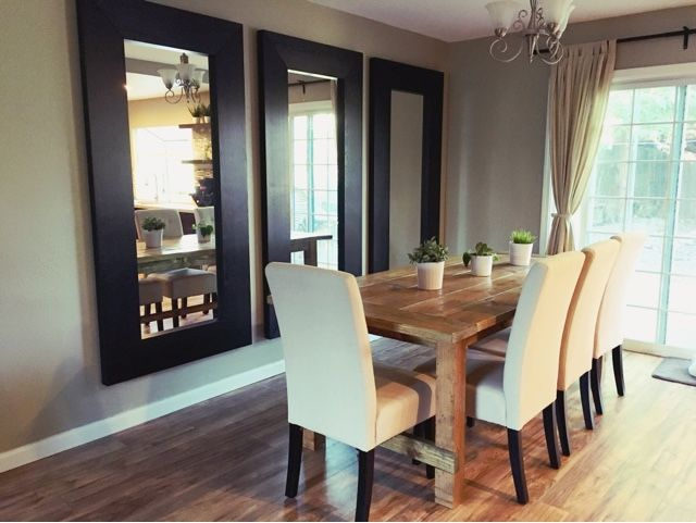 Vertical mirrors behind the dining room table makes the space look taller, larger, and more modern!  @Bunker Hill Remodel: 3 Mirrors in the Dining Room