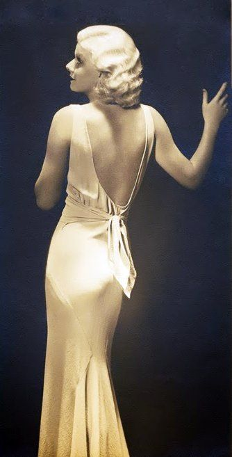 This is Jean Harlow. In the 1930s, dresses again became longer and touched the ground in comparison with the short dresses of the 1920s. The waistline came back to its natural position to emphasized womanly look