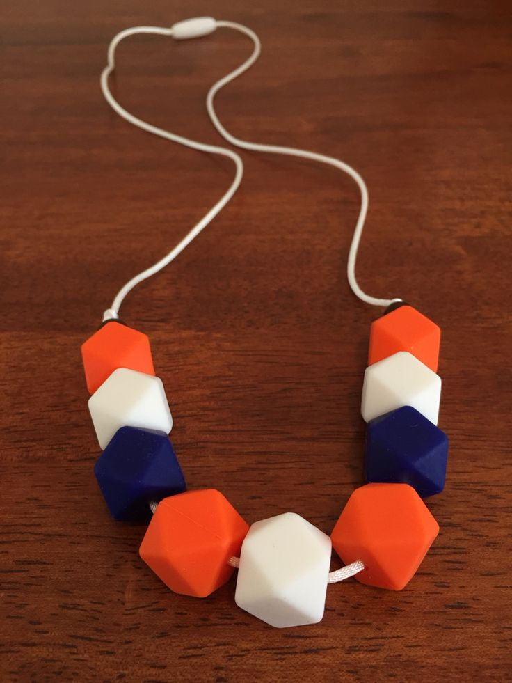 Fussy Little Fox Hexagon Teething Necklace in Orange, white, navy and chocolate on white nylon cord with white safety catch. $20 + Free Shipping within Australia. Visit Fussy Little Fox on Facebook to see more or email fussylittlefox@gmail.com to purchase.