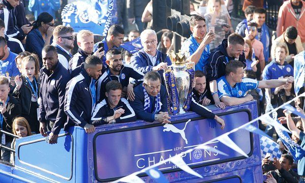 Leicester City parade Premier League trophy through packed streets | Football | The Guardian