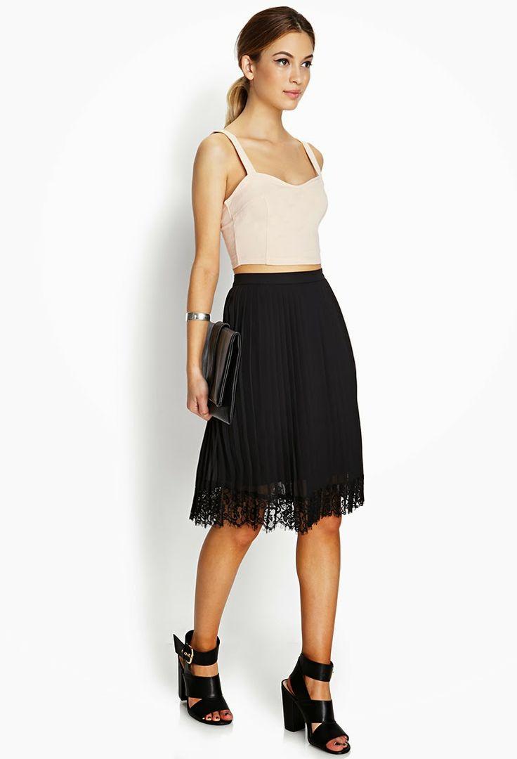 Falda plisada de tul negra.