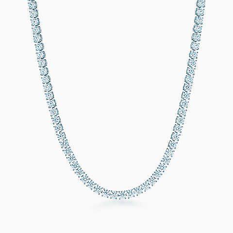 Diamond line necklace in platinum with round brilliant diamonds.