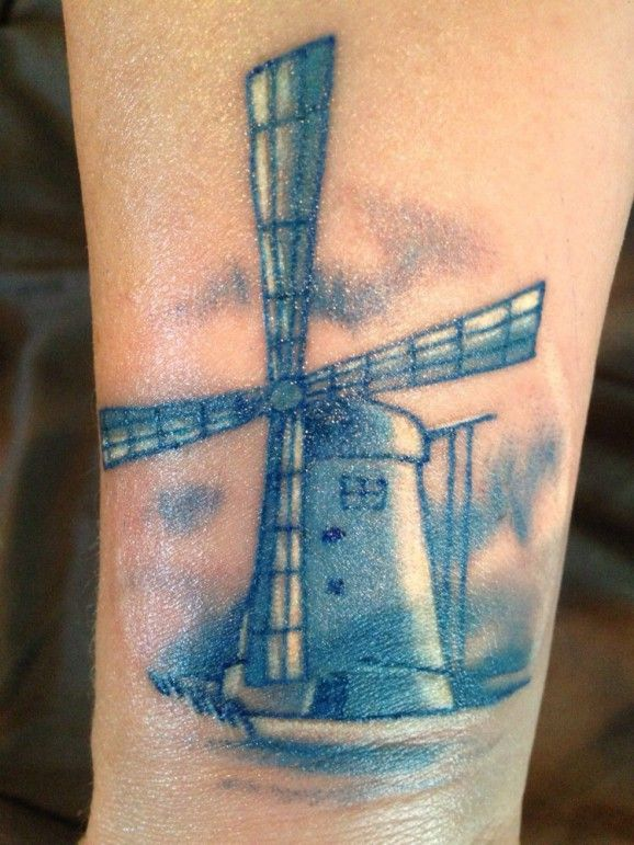 Delicate blue windmill by Inkies Tattoo Studio