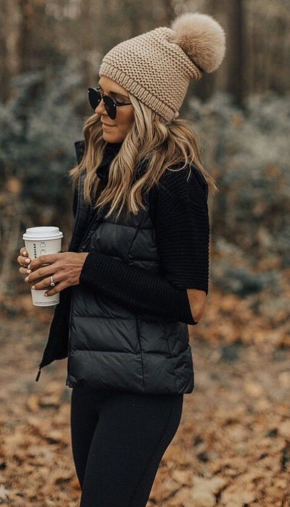 #winter #outfits black zip-up bubble vest with brown knitted bubble cap and black leggings