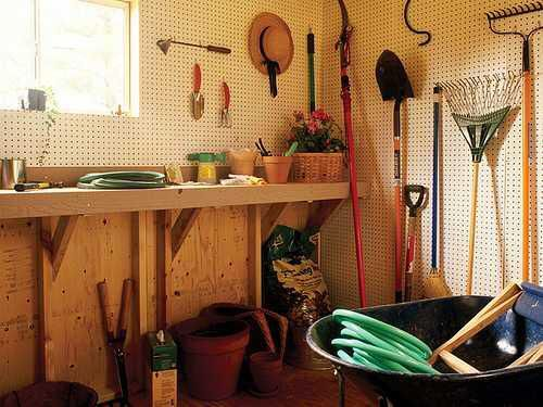 Pegboards Are A Low Effort Way To Keep Your Tools Off The Floor And  Organized. The Workspace In This Garden Shed Is What Dreams Are Made Of!