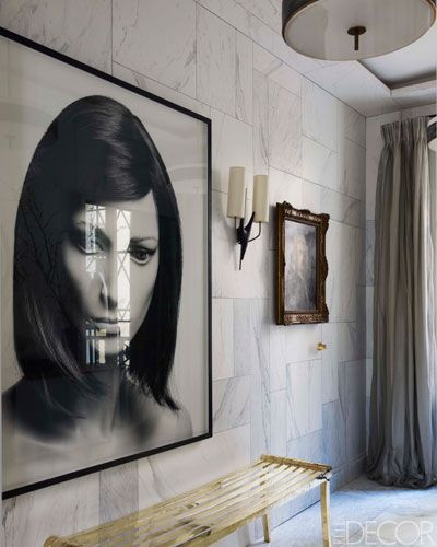 Jean-Louis Deniot--Entry--walls painted to match marble floor. Deniot designed the brass bench, the photograph is by Valérie Belin, and the sconce is by Georges Jouve.