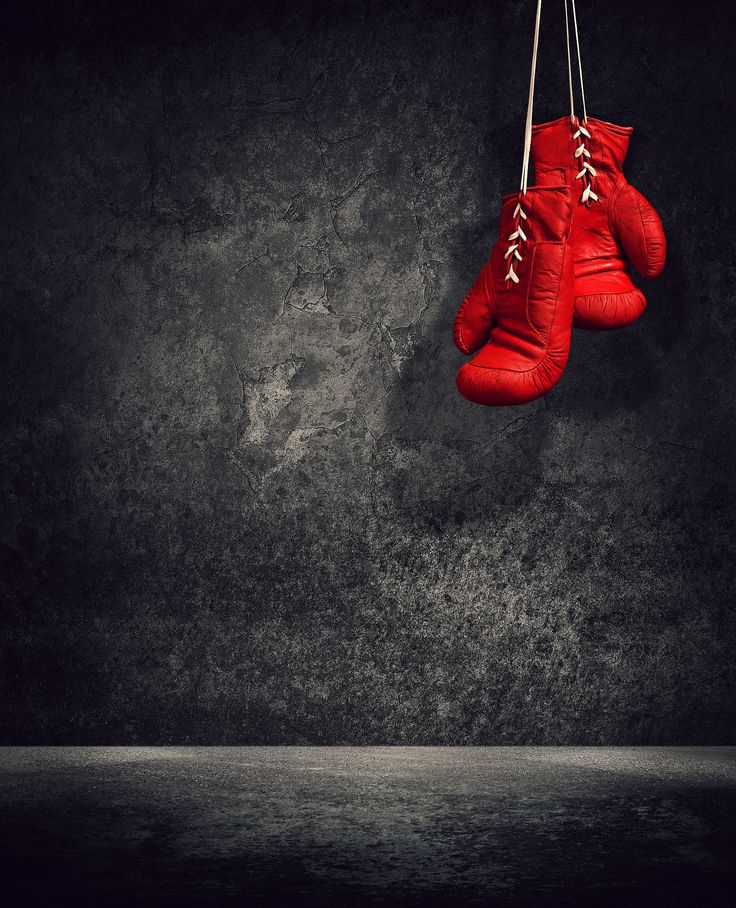 Red laced boxing gloves hanging