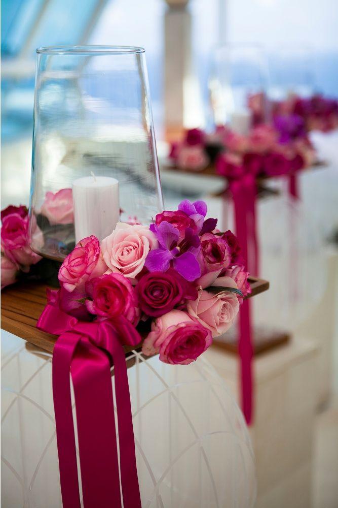 Aisle decoration in pink by Tirtha Bridal Uluwatu Bali