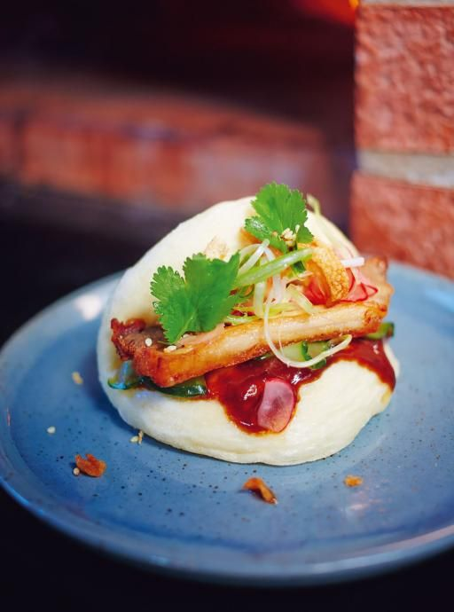 Irresistible steamed buns. Tasty party food The brilliant combo of these soft buns, sauces, pickles and meat will blow you away