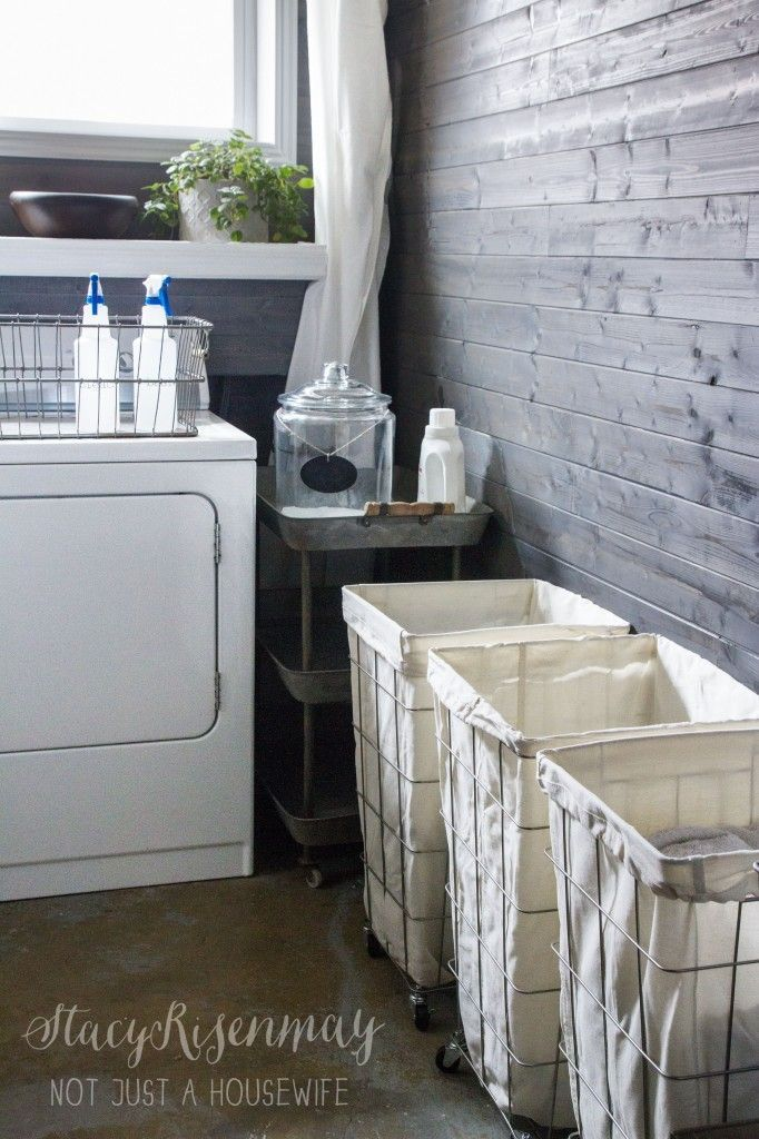 love that greyed plank wall. Great for behind a a washer and dryer.