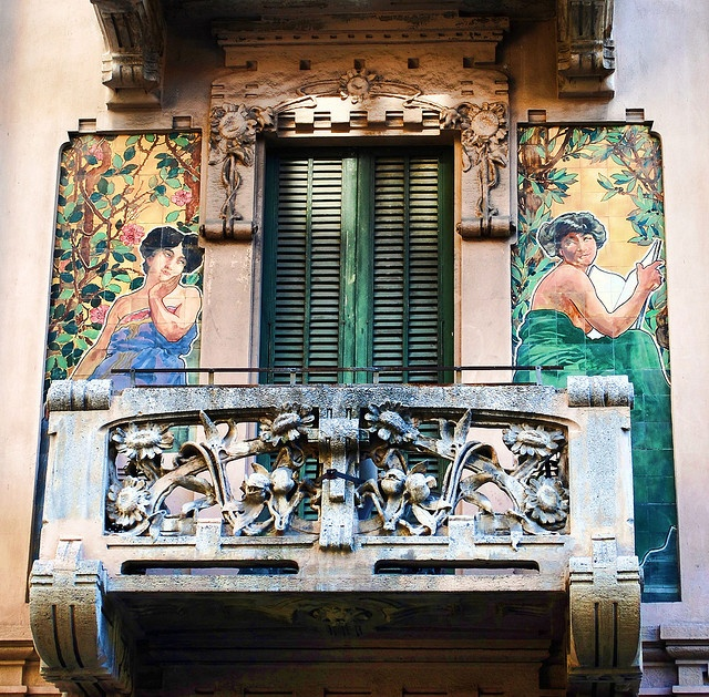 Milano. if you have a balcony above your front door, then embellish it.