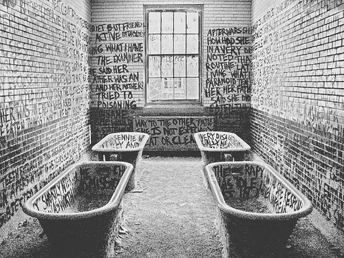 Graffiti in an abandoned mental institution. I saw this ...
