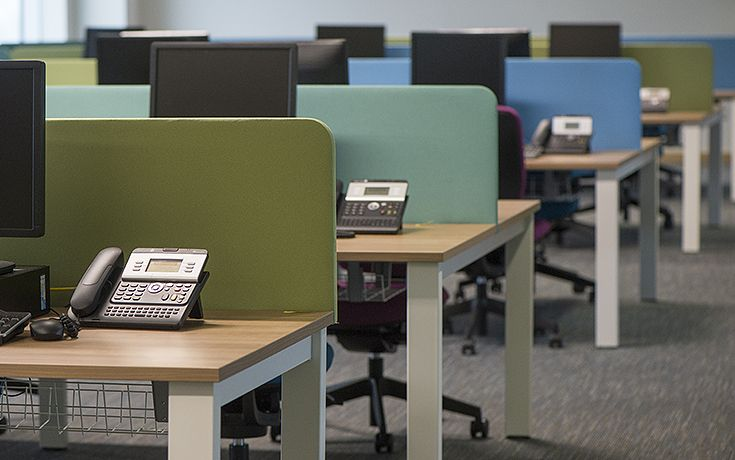 Colourful upholstered screens were used to define workstations along with Freeway desking