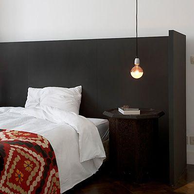 Black wraparound headboard - creates a nice little nook