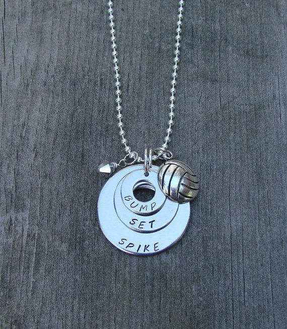 This necklace features three 18 gauge stainless steel washers, sizes 5/8, 7/8 and 1 1/4, hand stamped with BUMP SET SPIKE. Also attached is a