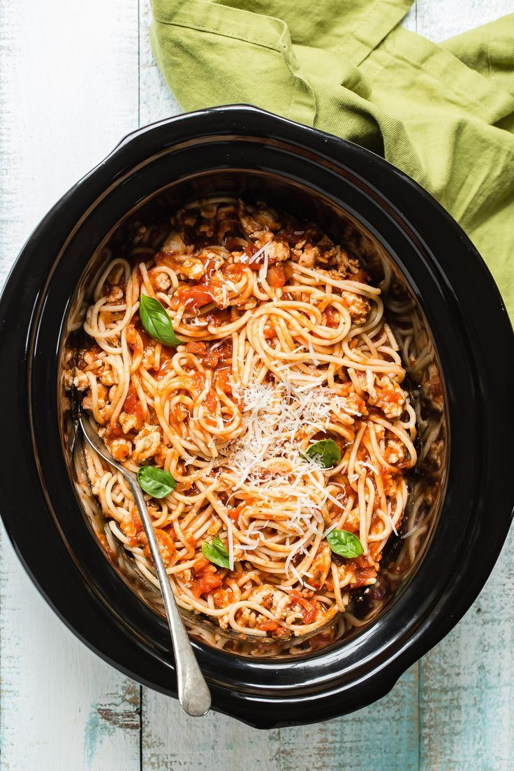 The Easiest Crock Pot Spaghetti from weelicious.com | Perfect weeknight family meal.  Its takes no time to make! #crockpot #spaghetti #slowcooker #pasta #pastanight #italian #italianfood #kidfriendly #recipes