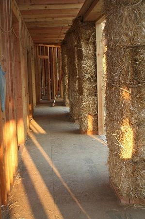 Straw bale interior  - Straw bales are at least 18 inches thick, making a pretty hefty wall.  Hefty and warm!  The insulation values are R-30 to R-35, so you can be sure your heating bill won't be through the roof each winter.
