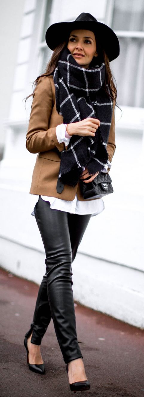 Donna Louise is wearing a J.crew blazer, black leather trousers from Zara, Christian Louboutin Pigalle shoes and an oversized scarf from Zara