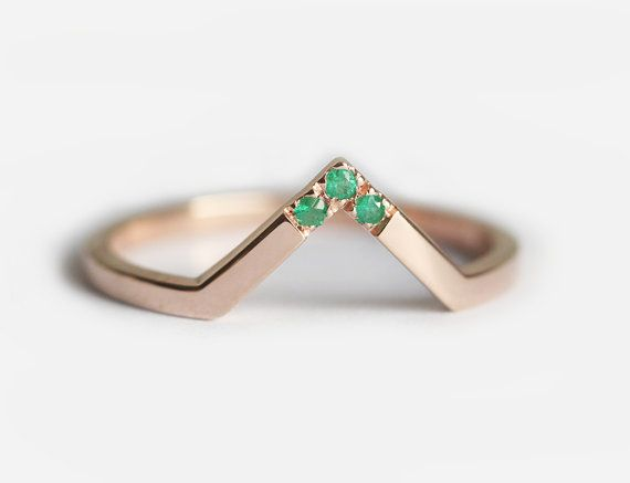 Elegant thin chevron ring with emeralds. This ring is 14K rose gold. This ring is designed for those who love simplicity with a slight twist. Perfect