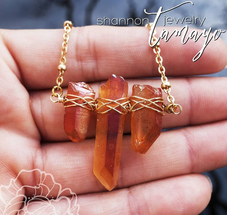 "3 radiantly hued crystal quartz points have been wire wrapped to create this unique raw gem statement necklace. What I find most unique and intriguing about these crystal quartz points is the way they glow in the sunlight - it's just incredible! The photos don't do them justice. The beautiful apricot crystal quartz points are framed by 17"" of brushed gold plated chain and finished with a brushed gold plated clasp. The crystal fan is 1 1/4"" long and 1 1/8"" wide. It is believed that all quartz…"