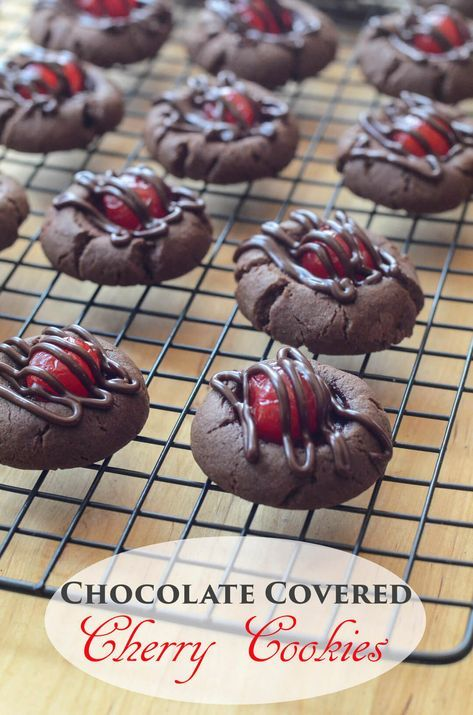 Fudgy, brownie like cookies with a sweet cherry peeking through a drizzle of cherry infused chocolate frosting ~ https://www.fromvalerieskitchen.com