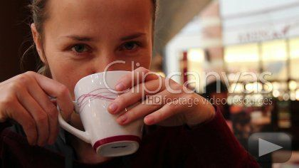 Beautiful girl enjoys coffee HD Stock Footage Clip. Close-up. 2010-06-11, POLAND.