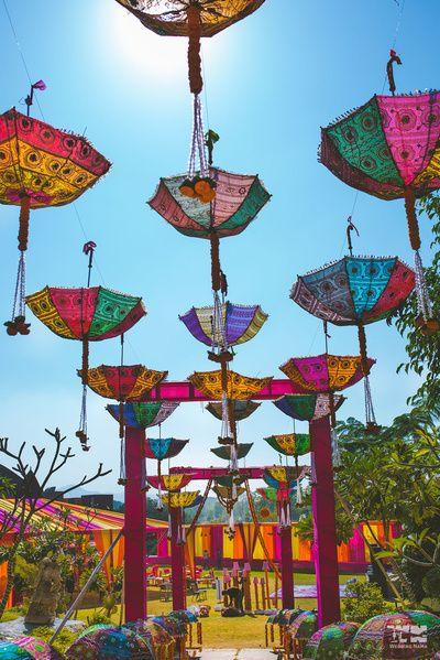 Mehendi Decor - Hanging Multi-colored Umbrellas as Mehendi Decor | WedMeGood #wedmegood #indianwedding #mehendidecor #decor #umbrella #hangingumbrellas asdecor #mehendidecorideas