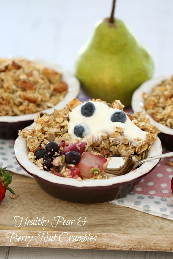 These Thermomix Healthy Pear & Berry Nut Crumbles are the perfect start to the day (or a completely guilt-free dessert). They're packed full of fresh fruit and then topped with a cinnamon, nut and oat crumble. Serve with greek yoghurt and extra berries for an extra yummy kick. #healthy #crumble #fruit #conventional #dessert #thermomix #baking #easy