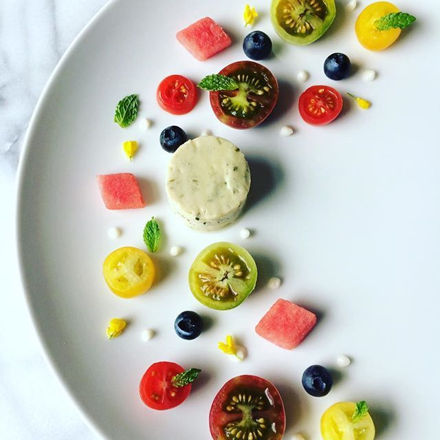 Organic mini heirloom tomatoes|watermelon|blueberries|mint|edible flowers|vegan chive cheese #cooking #farmtotable #organicfood #foodporn #theartofplating #healthyfood #healthyeating #gastroart #foodphotography #nutrition #foodie #tomatoes #heirloomtomatoes #watermelon #salad #vegan #paleo #mint #edibleflowers #dairyfree #glutenfree #blueberries #miyokoskitchen