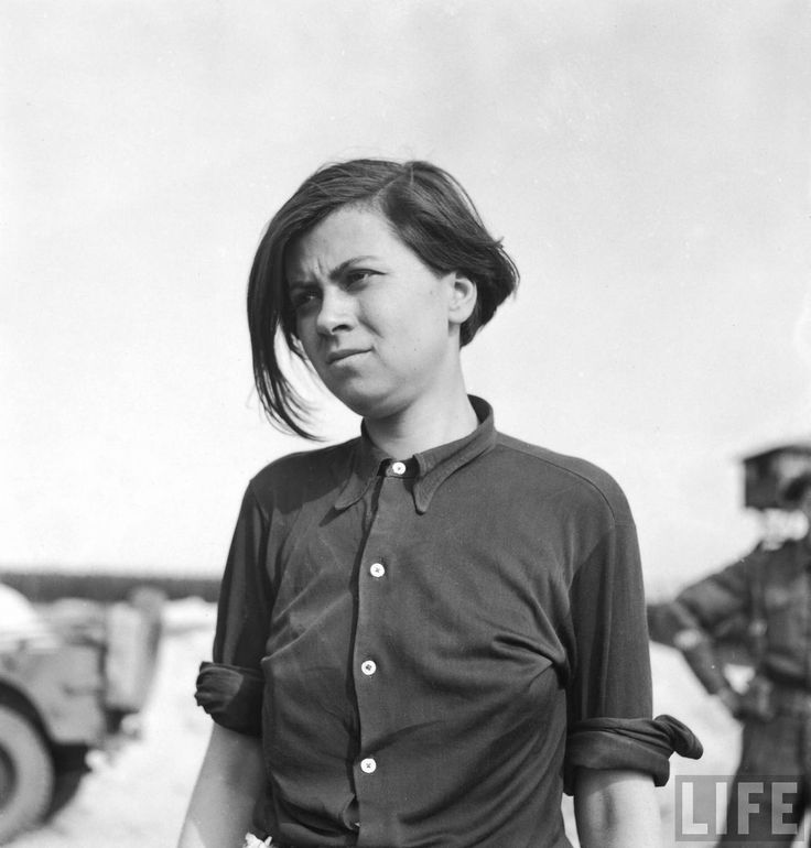 Annalese Kohlmann, former Nazi female guard noted for her cruelty, now a prisoner in the recently liberated Bergen Belsen concentration camp.  Location: Germany   Date taken: May 1945   Photographer: George Rodger