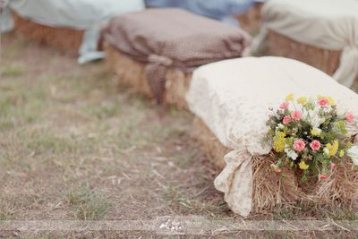 Burlap and lace wedding hay bale seating.