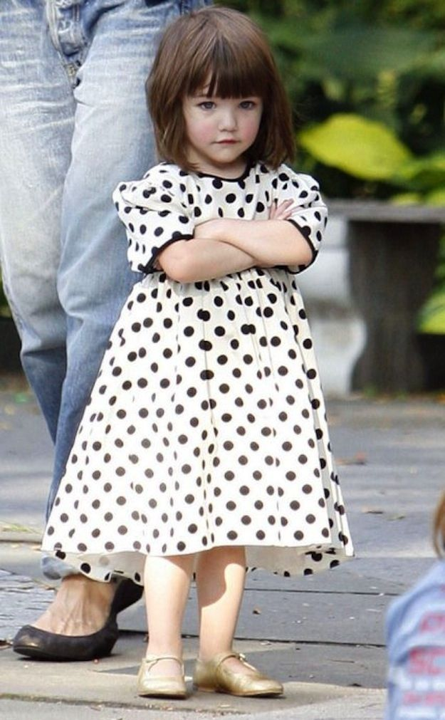 Six Years of Suri Cruise's BORED Face. She's still stinkin cute, but I bet she's a handful!