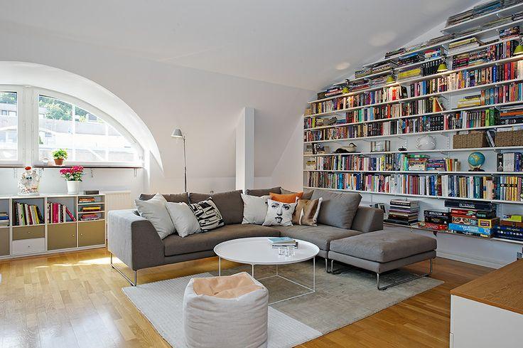 Corner couch and bookshelf