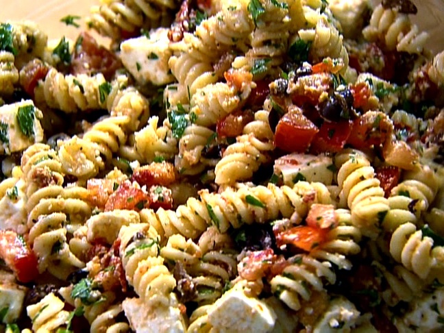 Food Network invites you to try this Tomato Feta Pasta Salad recipe from Ina Garten.