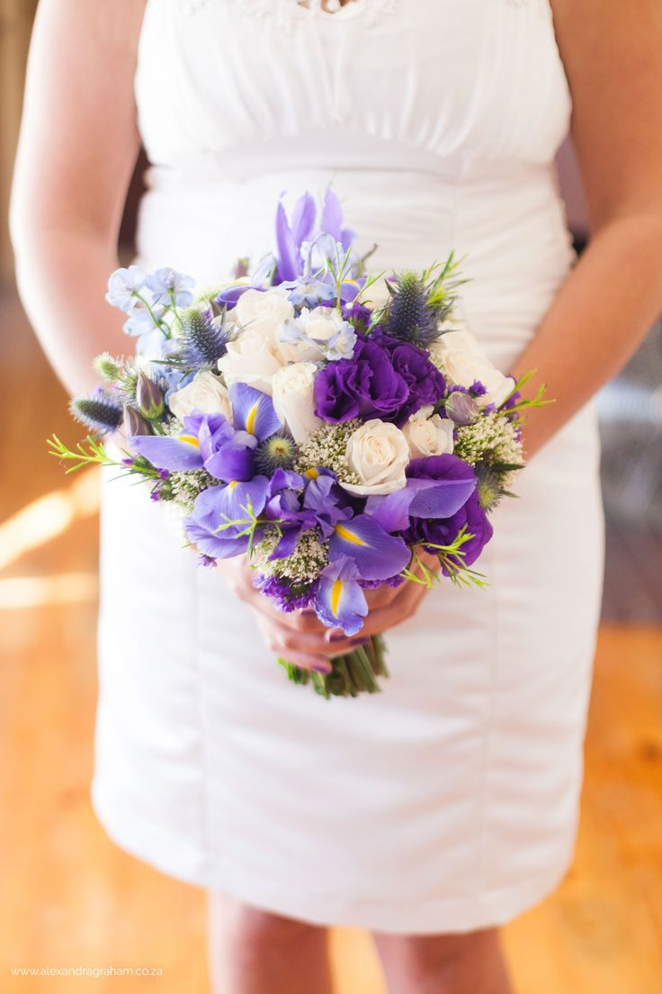 Bouquet of Blue Iris, sea Holly, purple, pale blue delphiniums and white lisianthus. Thanks to Alexandra Graham Photography
