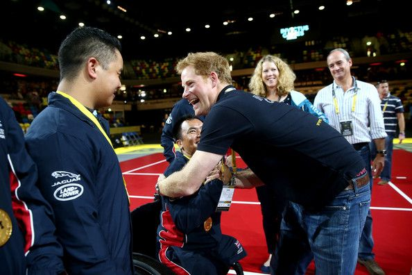 Prince Harry congratulates members of the gold medal winning Great Britain team after they win the Sitting Volleyball final match between Great Britain and the USA on Day Four of the Invictus Games at the Olympic Park on September 14, 2014