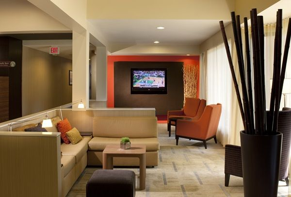 Spend some down time enjoying television in the Theater Lounge at the Courtyard Orlando International Drive.