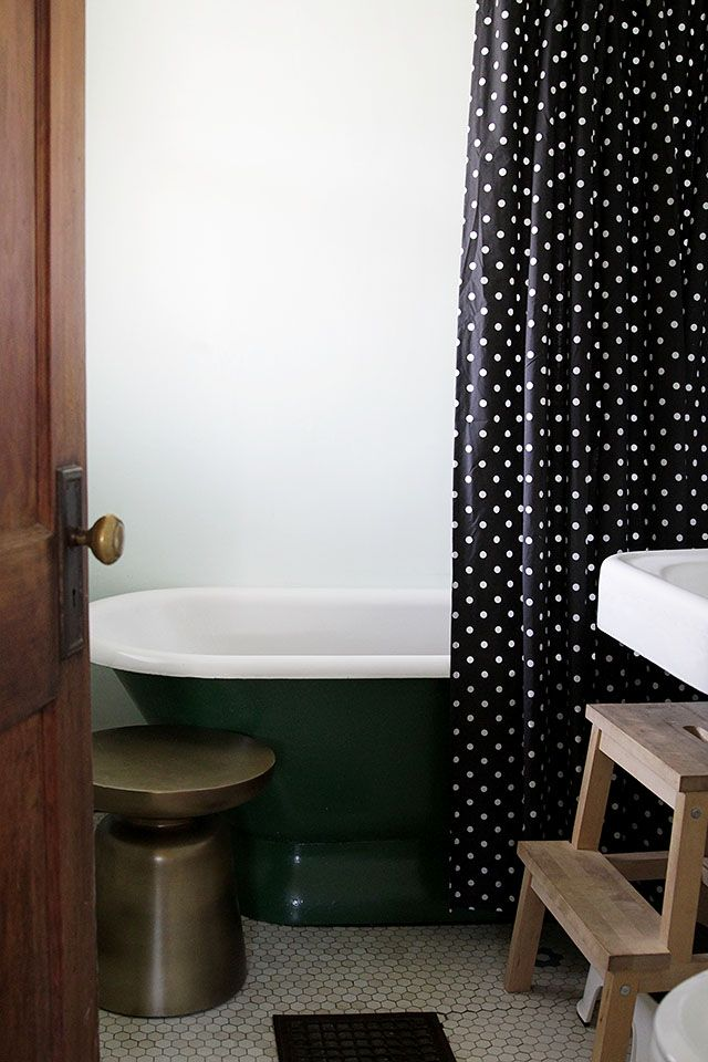 Here's the new shower curtain in the bathroom, along with the little bronze table/stool.