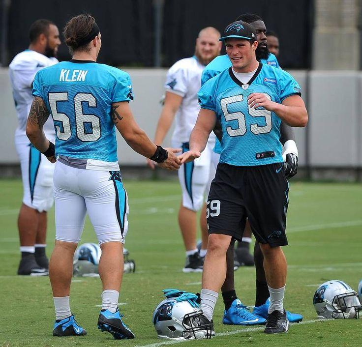 Carolina Panthers linebackers A.J. Klein, left, slaps