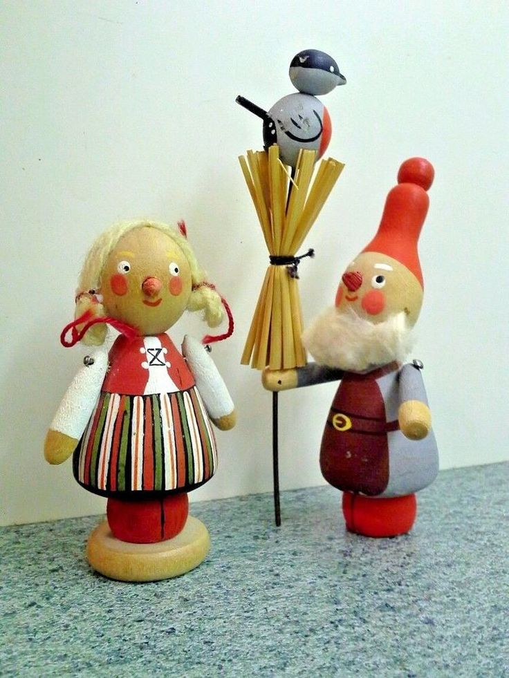 They are a cute couple of Scandinavian ethnicity, hand painted with traditional dress and adorable faces. The male has a tall red tomte style hat and white beard. He is holding a whisk broom with a bird perched on top.   eBay!